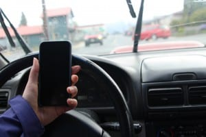 Tuesday night (4-26-16), the Sitka Assembly passed a law that would fine those using their phone while driving. Exceptions are made for hands-free use. (Photo courtesy of Her Campus Media)