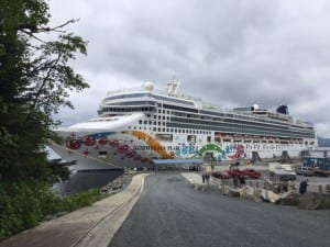 The Norwegian Pearl at Old Sitka Dock on Monday (5-9-16). Although industry experts believe more passengers will come ashore at OSD, some downtown merchants believe it takes them longer to arrive. (KCAW photo, Emily Kwong)