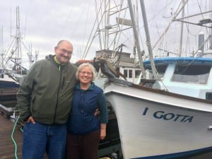 """Eric and Sara Jordan stand in front of their troller, the """"I Gotta."""" Eric says the unusual name came with the boat which he bought from his mother.  (KCAW photo/Katherine Rose)"""