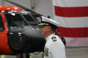 Relieved Air Station Commander Mark Vislay walks past one of the helicopters he's flown during his two years in Sitka. Vislay is being reassigned as a staff officer of the Coast Guard Commandant. (KCAW photo/Robert Woolsey)