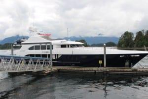 "The 165' motor yacht Rebel at the O'Connell Bridge Lightering Dock. Passengers from the cruise ship Silver Shado will lighter this weekend (Sat 7-2-16) to Crescent Harbor, so that super-yachts like the Rebel can moor here. With more ships landing at the privately-owned Old Sitka Dock, the city will transition this site to ""a super-yacht facility,"" said administrator Mark Gorman. (KCAW photo/Robert Woolsey)"