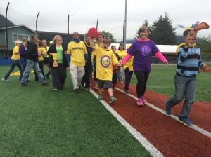 Carrie Spackman leads a group of cancer survivors and their caregivers around the bases at last weekend's Relay For Life event (Photo KCAW/Katherine Rose).