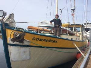 Jill Fredston, author and avalanche expert, stands aboard her boat docked in Eliason Harbor.