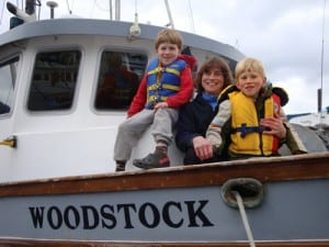 Linda Behnken with her sons, Halen and Rio. Behnken lives the small-boat fishing life she advocates for, but she's no stranger to IPHC politics. She's chaired the 84-member IPHC Conference Board for the last several years. (ALFA photo/Mim McConnell)