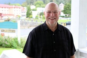 "Pastor Paul McArthur says Grace Harbor Church is just a tool for the ministry, like the ""hands and feet of its congregation."" He doesn't think the church changed much after its dramatic role in the slide recovery effort, although it did have to serve temporarily as a Catholic sanctuary. (KCAW photo/Robert Woolsey)"