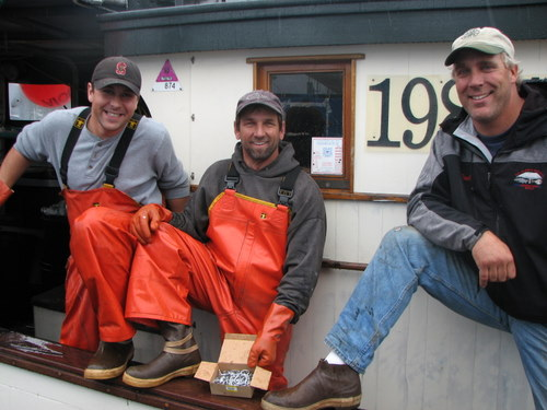 Crew aboard the F/V Sequoia show off their Xtratufs. Production of the popular boot is moving overseas. (KCAW photo by Ed Ronco)