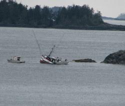 "Troller ""Igloo"" aground near runway, crew safe"