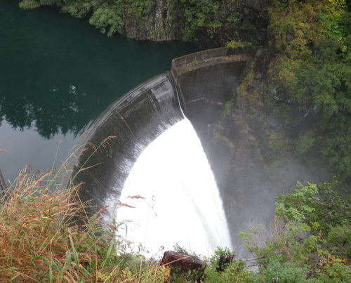 Blue Lake overflows its spillway in September. The city plans to borrow up to $45 million to help fund a project that will raise the dam's height by 83 feet. Construction is already happening. (Photo: Ted Laufenberg)
