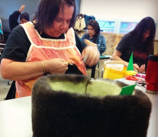 An otter-sewing workshop held recently in Kake showed craftspeople how to make hats and scarves. Image courtesy Sealaska Heritage Institute.