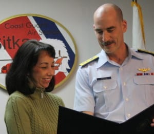 Rose MacIntyre receives an award from Rear Adm. Thomas Ostebo. MacIntyre was instrumental in forming the Sitka Coast Guard Spouses and Women's Association. (KCAW photo by Ed Ronco)