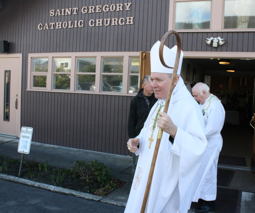 Juneau Diocese Bishop Edward Burns visits with parishioners outside St. Gregory Catholic Church in Sitka, after 11 a.m. Mass on Sunday, April 7, 2013. (KCAW photo by Ed Ronco)
