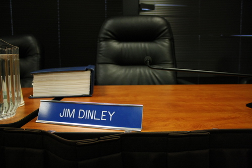 Municipal Administrator Jim Dinley's place at the Assembly table, photographed after the conclusion of Wednesday's meeting. The Assembly voted 5 - 0 to accept his resignation. (KCAW photo by Ed Ronco)
