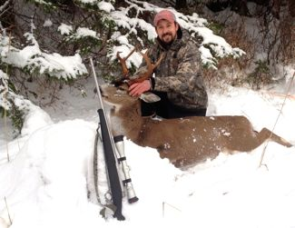 Jon Martin, assistan professor of Biology at UAS Sitka, with an impressive black-tailed buck last December. (Jon Martin photo)