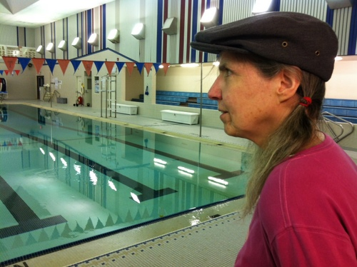 Jane Eidler looks out over the Blatchley Pool on Tuesday morning. Eidler has managed the pool full-time for seven years, and worked at it in some role since 1976. Hers is the second highest job on a list of potential cuts to balance the school district's budget. (KCAW photo by Ed Ronco)