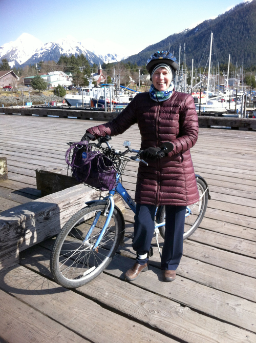 Sitka mayor Mim McConnell with her bike in April. McConnell is one of three Sitka assembly members who bike commute. A fourth drives an electric car. (Photo Sitka Bicycle Friendly Community Coalition)