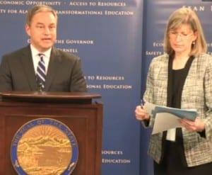 Gov. Sean Parnell  signs budget bills in Anchorage Tuesday as Budget Director Karen Rehfeld handles paperwork.