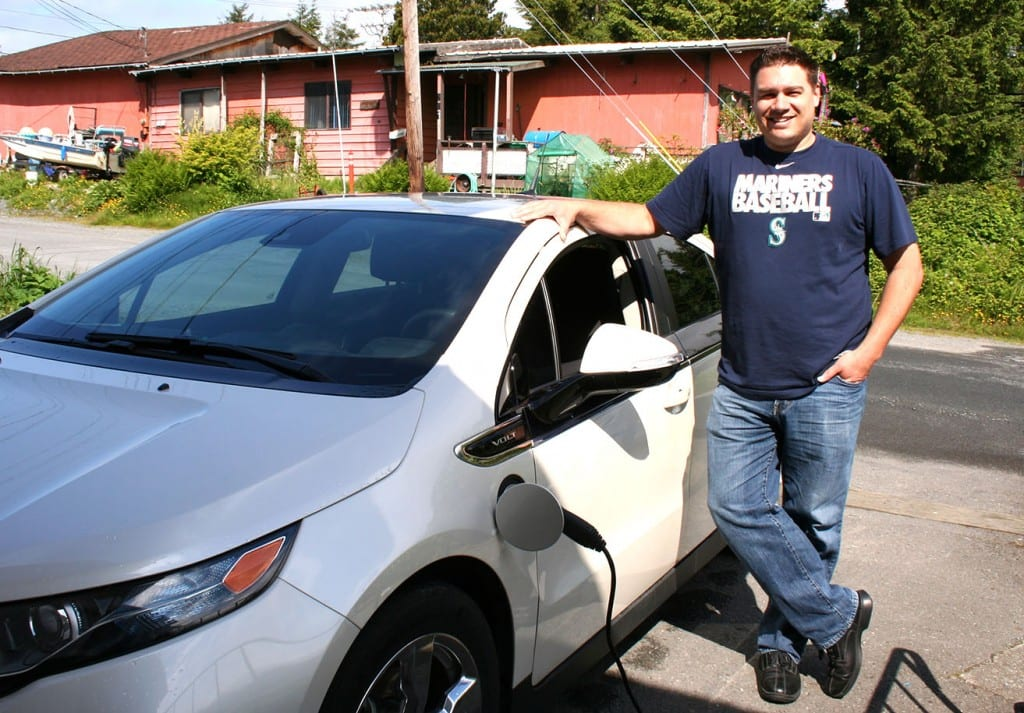 Sitka's lone electric car owner, Michael Mahoney, standing next to his Chevy Volt. (KCAW photo by Erik Neumann)