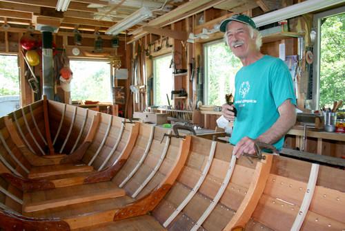 Mark Howey at work on his Lowell dory skiff. (KCAW photo / Erik Neumann)