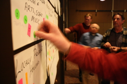 Attendees at the Sitka Economic Development Association's 2013 Economic Forum vote on ideas to help Sitka's economy. Helping with the further development of the Sheldon Jackson campus, and Sitka's arts community, was among the top vote-getters. So was mining. The Assembly will decide whether to explore Sitka's mining potential during its Tuesday meeting. (KCAW photo by Ed Ronco)