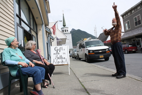Jude Reis and Pamela Ash (left) talk with Stan Schoening outside the Baranof Island Artists' Cooperative on Wednesday afternoon. A plan to close this stretch of Lincoln Street to vehicles was canceled by the Sitka Assembly at its regular meeting on Tuesday. (KCAW photo by Ed Ronco)