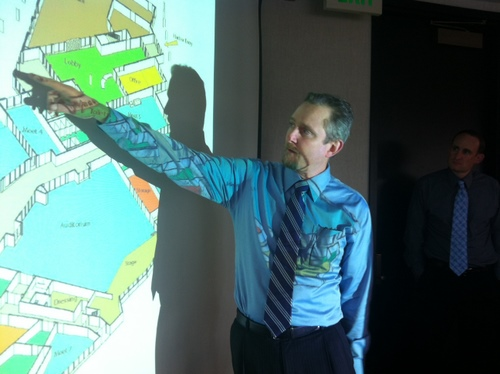 Architect John Weir, of the Anchorage firm McCool Carlson Green, shows the proposed floor plan for Harrigan Centennial Hall in Sitka. The public can weigh in on the plans at a meeting Tuesday inside Centennial Hall. (KCAW photo by Ed Ronco)