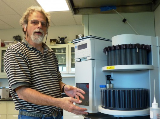 Ron Heintz discusses the gulf groundfish project while checking equipment in one of NOAA's Juneau labs. Photo by Ed Schoenfeld, CoastAlaska News.