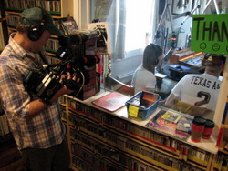 A cameraman, Will, from the Weather Channel's Coast Guard Alaska films the show.
