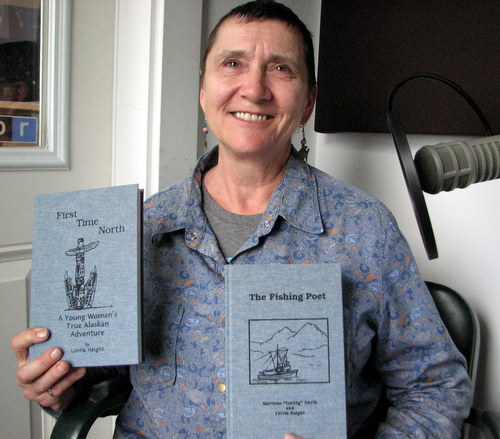 "Author Lorrie Haight with handbound copies of her memoir and a collection of the late Harrison ""Smitty"" Smith's poetry. (KCAW photo/Robert Woolsey)"
