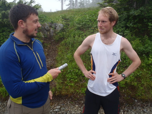 Sentinel sports editor Tom Hesse (l) interviews defending Alpine Adventure Run champion Sam Scotchmer following his record-breaking win.