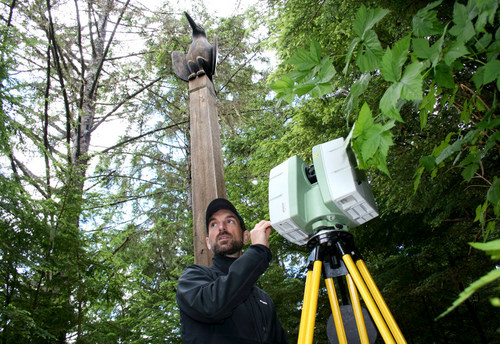 National Parks Service architect Jeremy Mauro operates a machine to digitally scan totem poles in Sitka's National Historical Park.
