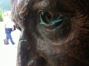 The gouge on Baranov's nose, and several on the head, were reported to city staff on Monday, but have probably been there about a month. When the statue was originally unveiled, someone vandalized its nose, but the artist then was able to repair the damage quickly. (KCAW photo by Ed Ronco)