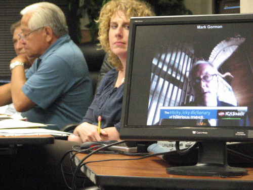 Sitkan Mark Gorman -- like all the semi-finalists -- interviewed in this round via videoconference. Deputy municipal clerk Sara Peterson and deputy mayor Pete Esquiro look on. (KCAW photo/Robert Woolsey)