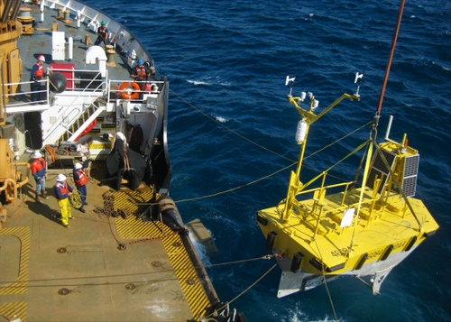 The crew of the 225-foot Coast Guard Cutter Maple redeploys a NOAA weather data buoy 29 miles southwest of Cape Edgecumbe, near Sitka, Aug. 20. The cutter crew originally recovered the buoy in September 2012 when it became adrift in the Gulf of Alaska. (U.S. Coast Guard photo by cutter Maple)