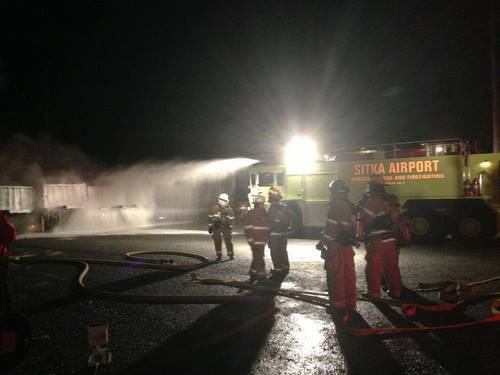 The state Department of Transportation's Airport Rescue and Firefighting truck sprays foam on a fire at the end of Granite Creek Road early Monday morning. About 15 Sitka firefighters responded to the incident around 1:30 a.m. (Photo provided by the Sitka Fire Dept.)