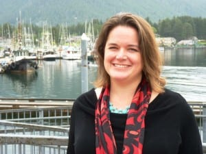 Analyst Meilani Schijvens stands by Sitka's Crescent Harbor and lightering dock. She  told the Southeast Conference fishing and tourism are growing in the region. CoastAlaska News photo)