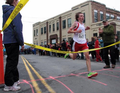 Sitka High freshman David Wilcox blazes across the finish line Saturday morning. (KCAW photo/Robert Woolsey)