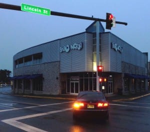 Stereo North's owners object to a new bus site they say will take away customer parking. City officials say it's the safest location.