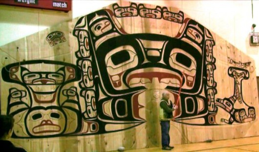 Master carver Gordon Greenwald describes the Huna Tribal House interior screen at its unveiling in Hoonah. (Mary Beth Moss/Glacier Bay National Park)