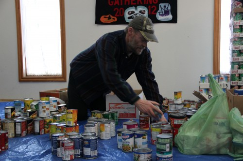 A Salvation Army Volunteer sorts Thanksgiving canned goods.(photo by KCAW's Emily Forman)