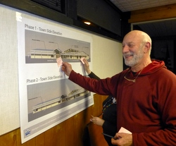 Sitka Summer Music Festival board member Jim Steffen adds his comments to the renderings. (KCAW photo/Rich McClear)