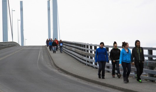Students from Mt. Edgecumbe High School walk across the O'Connell Bridge toward downtown Sitka. (Photo courtesy of Walk Sitka)