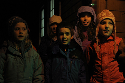 Students with the Sitka Fine Arts Camp after school choir performed a version of 'The Twelve Days of Christmas' with a Southeast Alaska twist. (KCAW photo/Rachel Waldholz)
