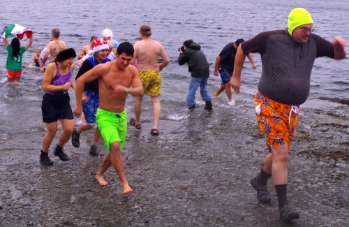 Eric Jordan (r) leads the charge up the ramp at Saturday's dip. (KCAW Photo/Rich McClear)