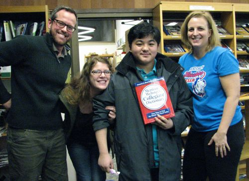 Spelling Bee winner Kyle Vidad and Blatchley Language Arts teachers (and Bee judges) Alexander Allison, Janelle Farvour, and Emily Demmert. (KCAW photo/Robert Woolsey)