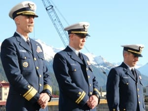 From right to left: Coast Guard District 17 commander Rear Admiral Thomas Ostebo; Maple executive officer Lt. Raymond Reichl; and Lt. Commander Michael Newell bowed their heads during the chaplain's invocation during the Assumption-of-Command ceremony. (KCAW photo/Rachel Waldholz)