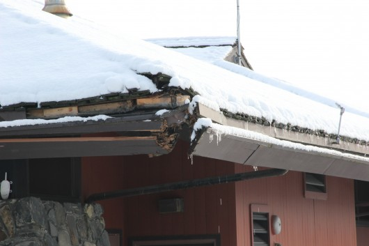 Delivery truck puts dent in library roof