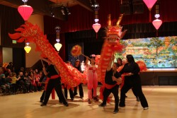The Mayo family performs a traditional dragon dance for Chinese New Year. (KCAW photo/Emily Forman)