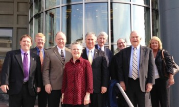 Rep. Peggy Wilson and lawmakers from other states pose Oct. 30 at the U.S. Department of Transportation during a Conference of State Governments Transportation Policy Academy. (CSG photo)