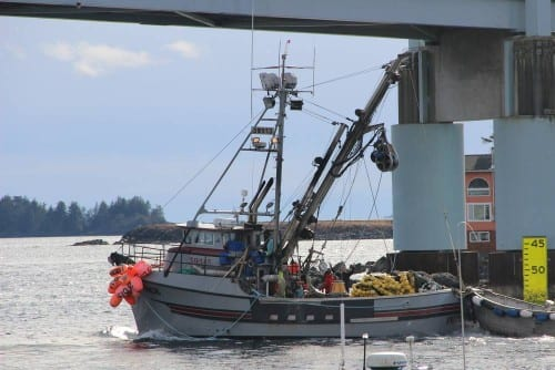 A seiner crosses beneath O'Connell Bridge during a day off in the 2014 Sitka Sound sac roe herring fishery (KCAW photo/Rachel Waldholz)