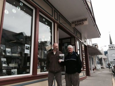 """Richard Carstensen (l) and Bob Armstrong in front of Sitka's Old Harbor Books. The new edition encompasses """"twenty-two years of learning,"""" says Carstensen. (Marjorie Hennessy photo)"""